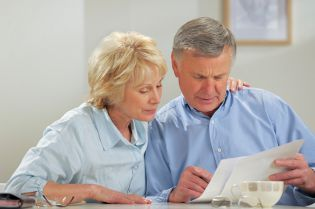 Couple viewing document - power of attorney