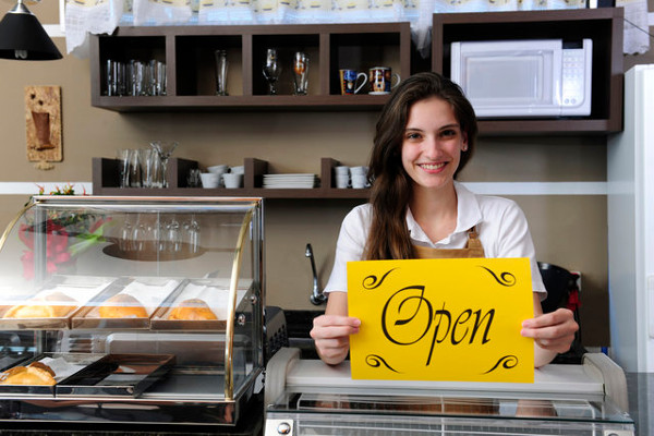 woman-small-business-owner-open-storefront